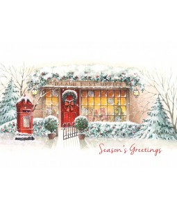 A traditional Christmas card pack with a lovely door decorated with a wreath